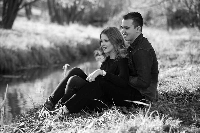couple relaxing by pond