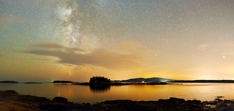 """Sharing in 2017 - 31 December 2016<br /> <br /> Milkyway over Acadia National Park<br /> <br /> (full-sized version is here:  <a href=""""http://www.tom-hill.biz/Galleries/Scenics/Maine/i-w8WB2v9/A"""">http://www.tom-hill.biz/Galleries/Scenics/Maine/i-w8WB2v9/A</a>)<br /> __________<br /> <br /> So ends 2016.  Looking back you can easily see I didn't write very much in my blog this past year.  Looking even a bit further you'll see I haven't written much of anything the last couple of years.  I'm not sure what the cause of that is.  If there's a new years resolution is a commitment to contribute more to my blog in 2017.<br /> <br /> One thing I noticed is related to sharing.  Sharing is a wonderful gift to whomever you share with.  On recent travels I listened to the an episode of NPR Ted Talk that discussed this precisely.  One thing the show noted was the intangible contribution you have when you share with no strings attached.  In other words, it was about the benefit of sharing your stuff with no expectation in return.  I found that whole concept interesting.<br /> <br /> I find it interesting because many folks might balk at the idea of giving up something for nothing.  They might say, """"what's the point if there's no direct benefit.""""  Well, that's a good point until you look a little deeper.  There are definite underlying benefits when you share.  In fact, some might say giving stuff that matters to you away pays off bigger in the long run than being totally committed to the bottom-line.  I agree.<br /> <br /> While I was driving down the road listening to this discussion my mind wandered to my website, www. tom-hill.biz.  You see, years ago I transformed my relationship with photography from a vocation I was trying to do full-time to a mindset that embraces the freedom of not making money.  Instead of constantly trying to sell a print to whomever I talked to, I changed to only talking about photography when the subject naturally came up.  Then, and only then, did I t"""