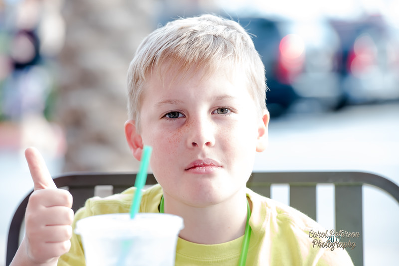 Matthew eating a blueberry muffin and having an ice water before going in to get his haircut.  He is used to me taking his picture wherever we go, even if it is sitting outside, enjoying a snack.  LOL