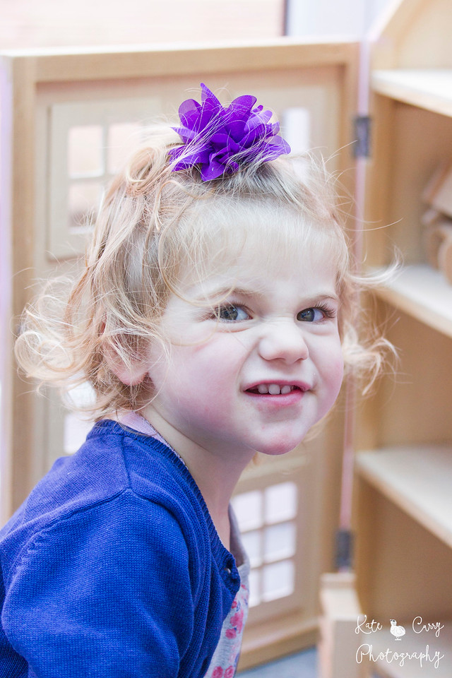 Toddler in purple pulling a funny face