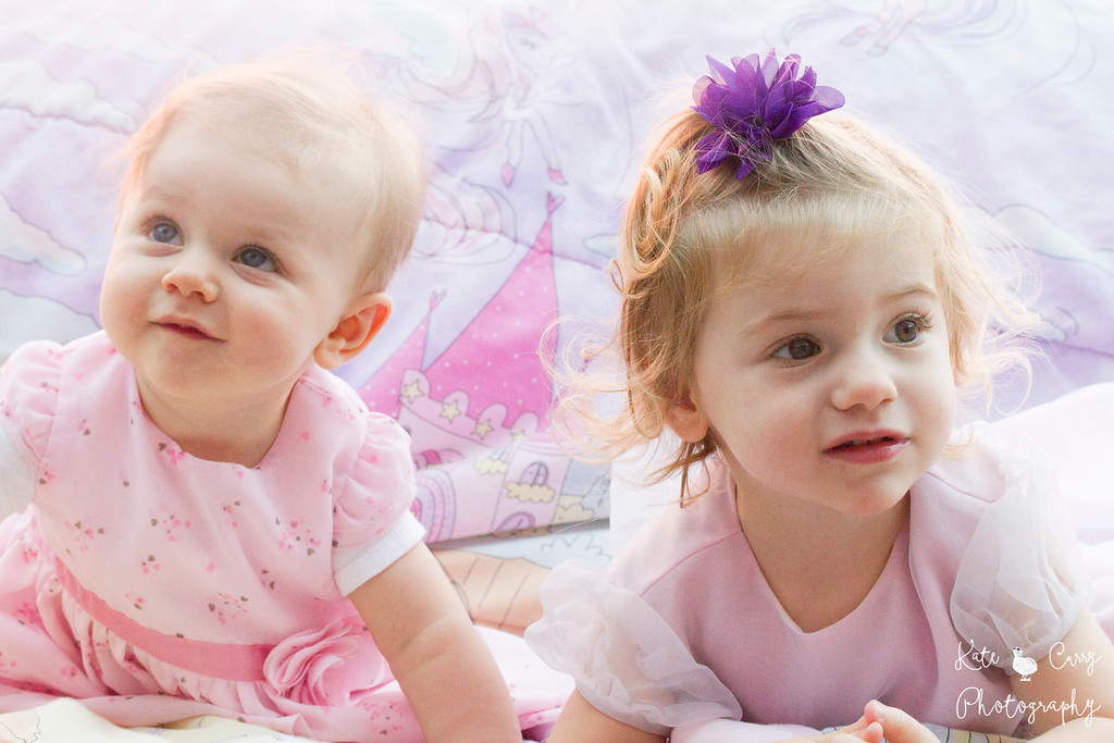 Young cousins dressed in pink dresses