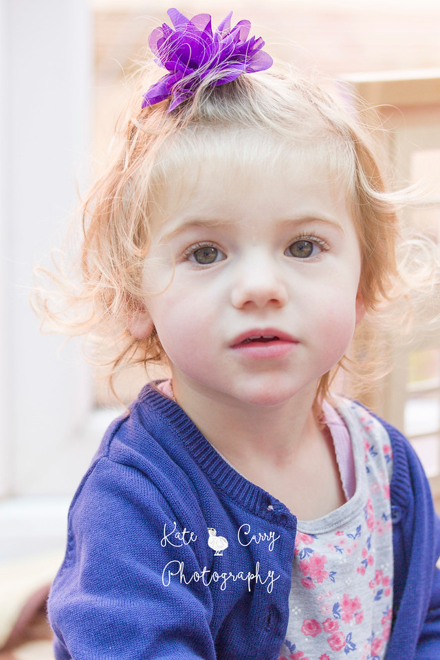 Toddler in purple