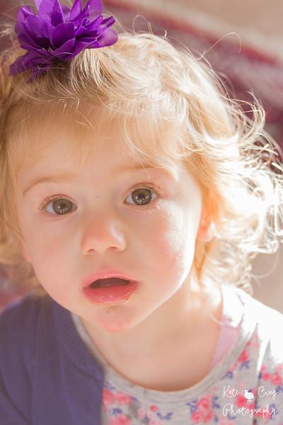 Toddler in purple in sunlight