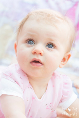 Baby wearing pink with big blue eyes