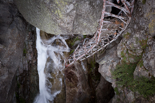 The twisted remains of the old bridge across Lone Pine Creek