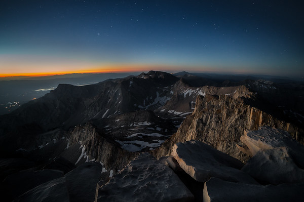First view from the summit: alpenglow on Mount Whitney, stars in the sky. You can see the curvature of the earth!
