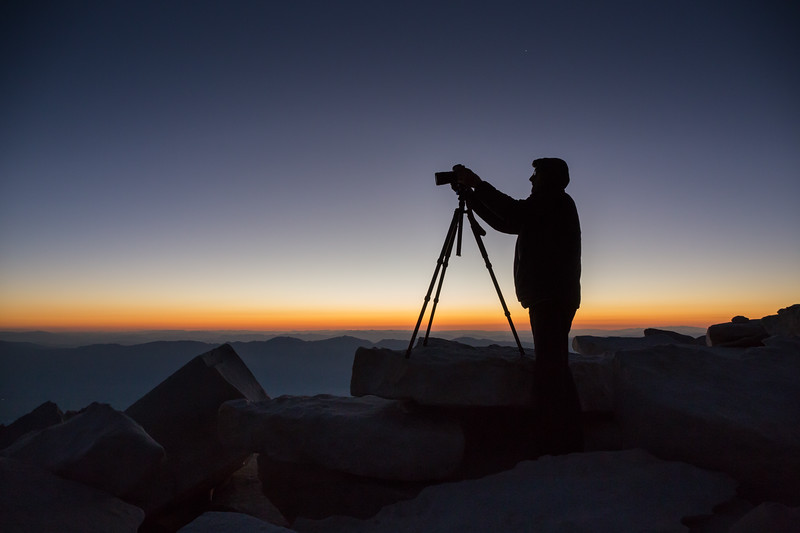 Marcel capturing sunrise while wearing all of his clothes