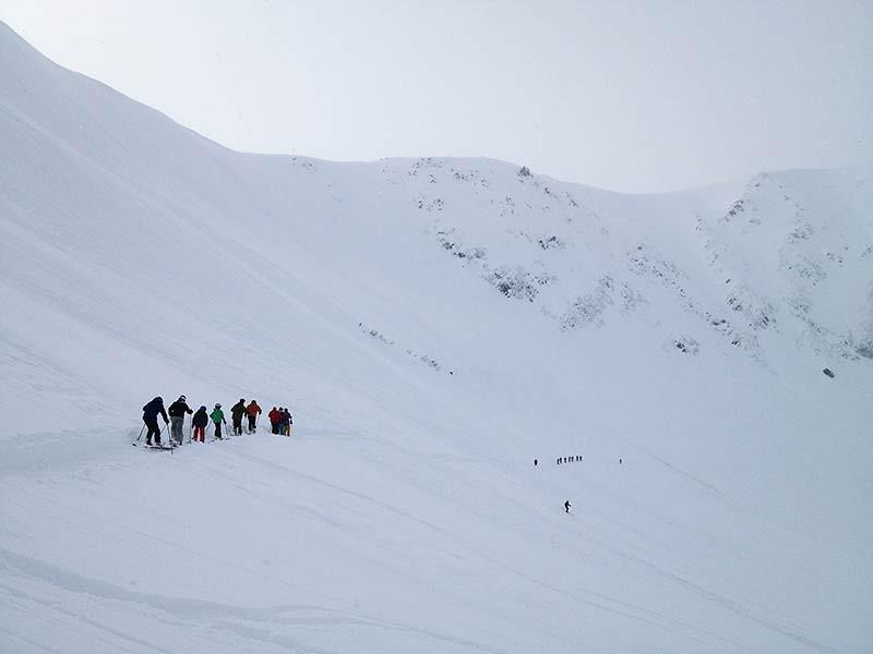 Skiers on High Traverse at Alyeska. (Photo: Kim Olson)