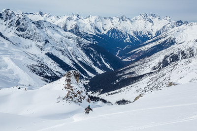 Skier starting down the Seven Steps to Paradise in Rogers Pass. 50 Classic Ski Descents of North America.