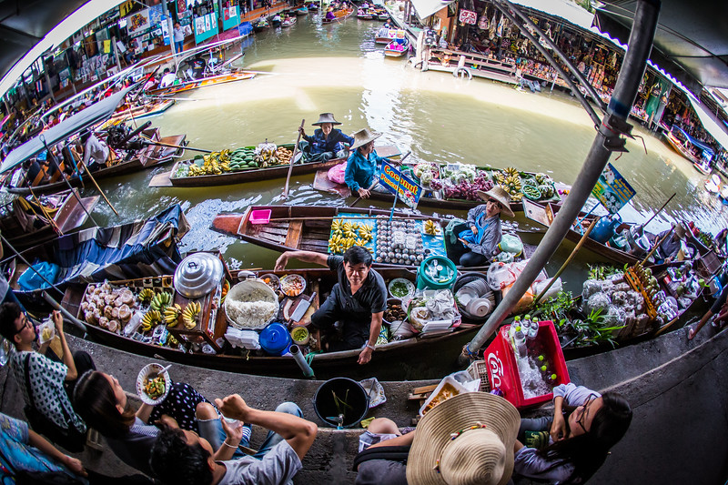 merchants at The Floating Market with an abundance of food