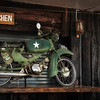 "an old motorcycle used in the classic movie ""Bridge Over the River Kwai"""
