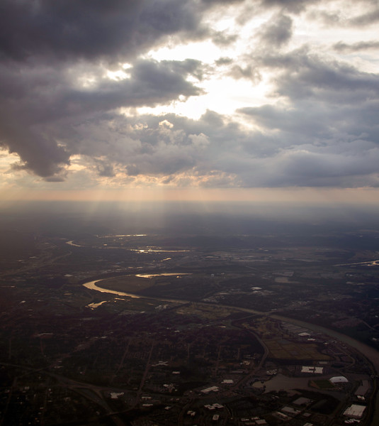 Sunlight shining through clouds and glinting off a river from the air near Nashville