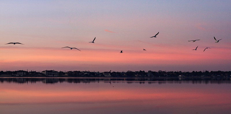 Sunrise over Clear Lake in southeast Houston. 3 photo panorama