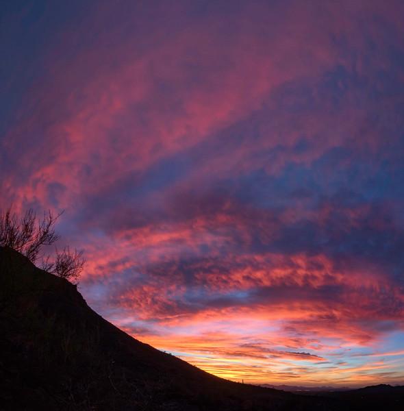 Blazing sunset at Gates Pass outside of Tucson, AZ. 4 photo panorama
