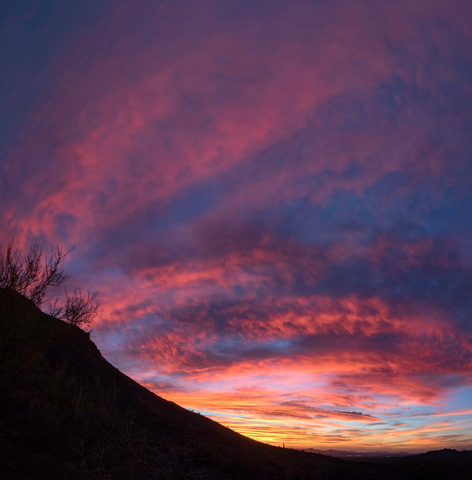 Blazing sunset at Gates Pass outside of Tucson, AZ. 4 photo panorama