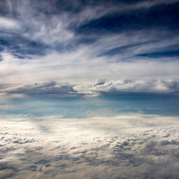 Clouds from the air above Houston. 4 photo panorama