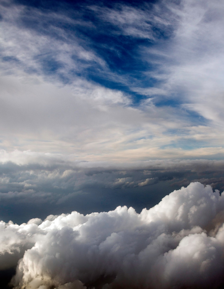 Clouds from the air above Houston. 6 photo panorama