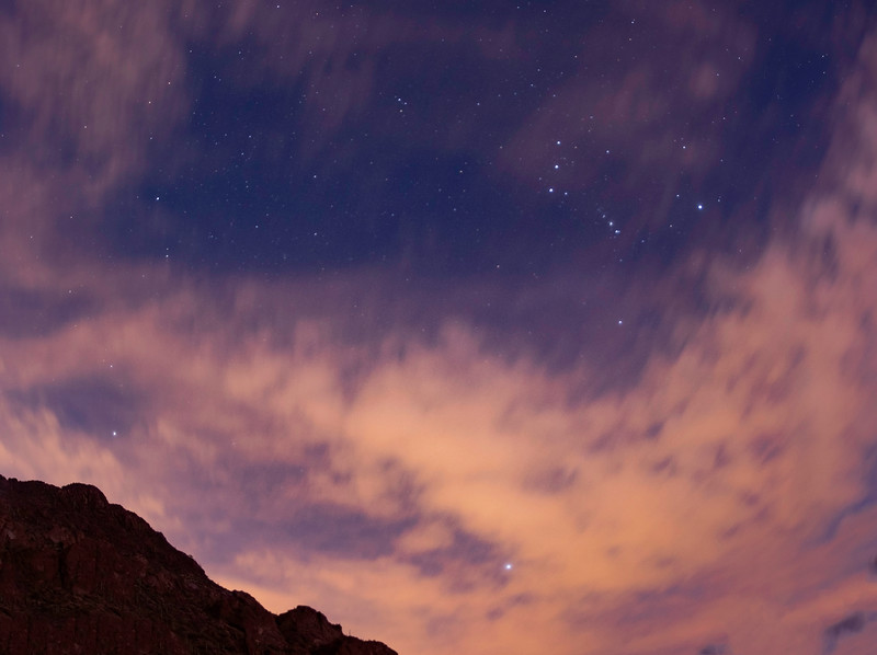 Clouds partially obscuring the stars at Gates Pass outside of Tucson, AZ. Orion and Sirius are visible. 2 photo panorama