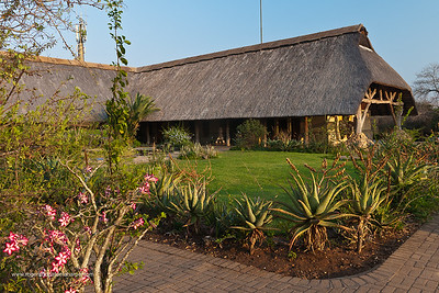 Skukuza Camp Reception Centre. Kruger National Park. Mpumalanga. South Africa. Skukuza is the main camp in the Kruger National Park. The name, adapted from Sikhukhuza (isiZulu), was a nickname for James Stevenson-Hamilton. It could be translated as 'a new broom', as Stevenson-Hamilton swept the area clean of poachers and outlaws. Skukuza is located in the southern part of Kruger and is the most popular and accessible camp, and one of the best for game viewing. In the vicinity of the camp all of the African Big Five can be found as well as other recognisable and exciting animals.