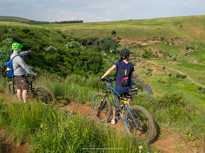 Howard and Debbie taking in the view on one of the All Out Adventures Mountain Biking trail. Northern Drakensberg. KwaZulu Natal. South Africa