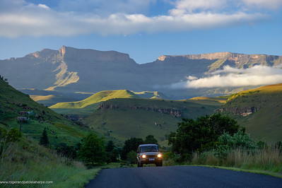 Road access to  Giants Castle Camp and view of Giants Castle. Ukhahlamba Drakensberg Park. KwaZulu Natal. South Africa