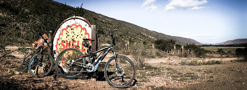 The Haibikes and an old sign at Kleinpoort. Baviaanskloof. Eastern Cape. South Africa