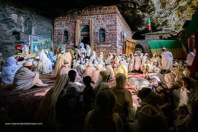 Pilgrims at a Christian religious ceremony in a cave (where there is a source of Holy Water) at St. Neakutoleab Monestry near Lalibela. Ethiopia.
