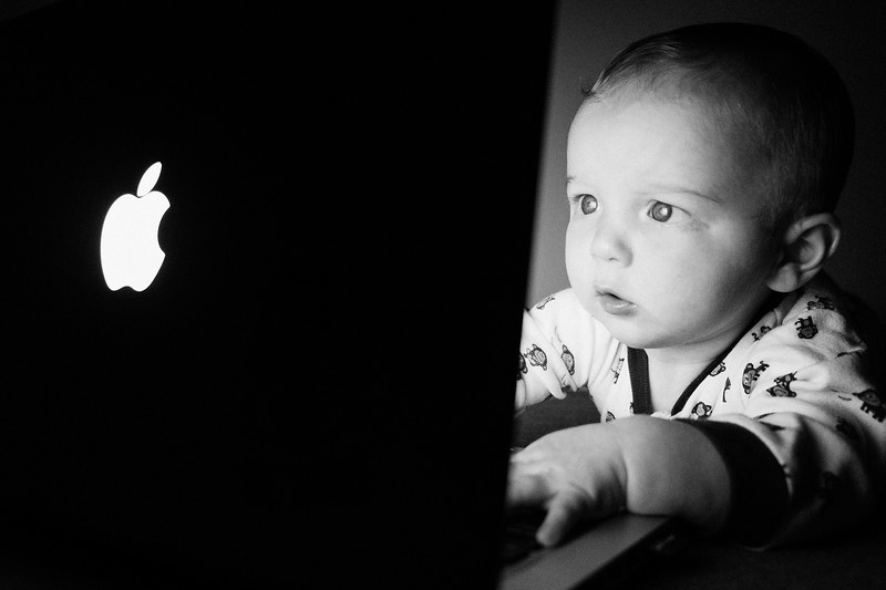 Photo taken a few months ago of my son. These young kids these days...whizzes with computers! Fuji X-Pro1 18mm 1/30sec, f2.8, ISO 6400