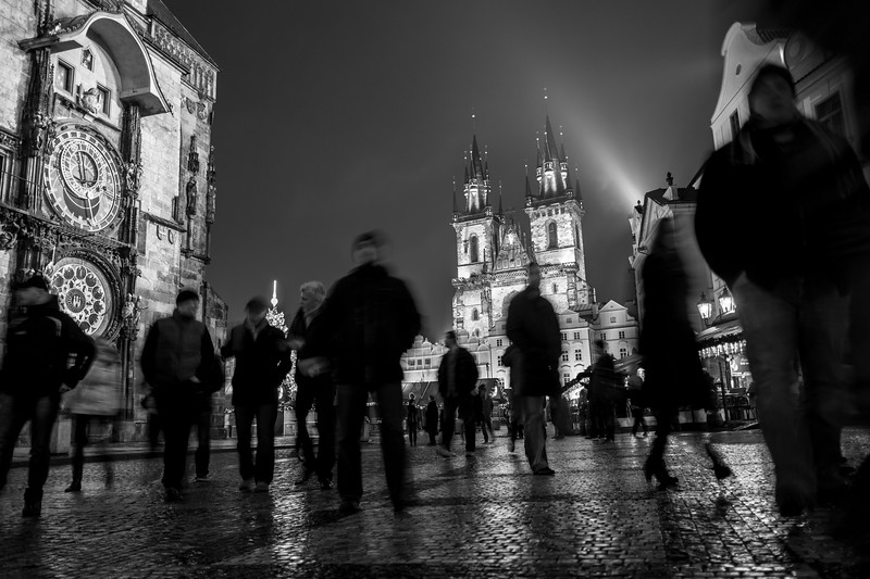Midnight at the Old Town Square, Prague next to the astronomical clock. The area was fairly empty until this unusual crowd of people converged in front of me.  1/4 sec at f/2.0, ISO 200, 18mm