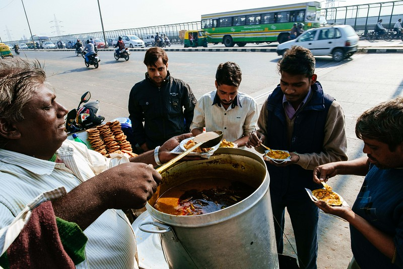 Dilli Chaat on the Eastern Approach bridge over the Yamuna River. Fuji X-Pro 1, 14mm, F/9, 1/140th, ISO 200.