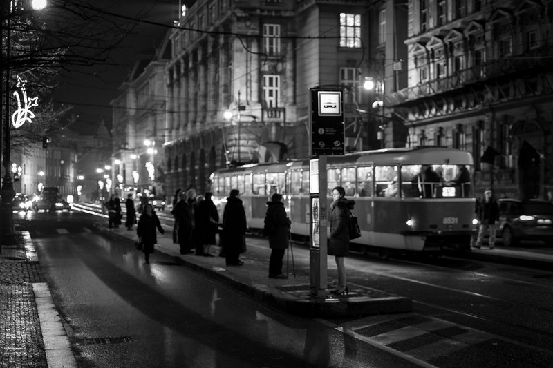 A street scene aoutside the Rudolfinum in Prague just shortly after a music concert let out. 1/30 sec at f/1.4, ISO 1250, 35mm