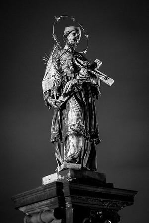 St. John of Nepomuk on Charles Bridge, Prague 1/60 sec f/1.4, ISO 5000, 35mm, light film grain added in LR.