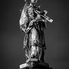 St. John of Nepomuk on Charles Bridge, Prague<br /> 1/60 sec f/1.4, ISO 5000, 35mm, light film grain added in LR.