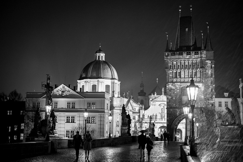 Wintery mix coming down heavily on the Charles Bridge, Prague 1/30 sec at f/1.4, ISO 800 35mm