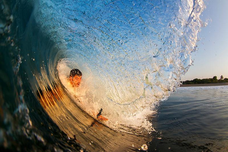 Jon from Thunderbomb Surf Camp sliding through an early morning barrel