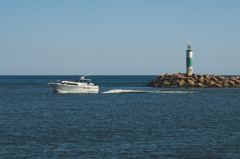 A Speedboat pass the Portage Breakwater Light