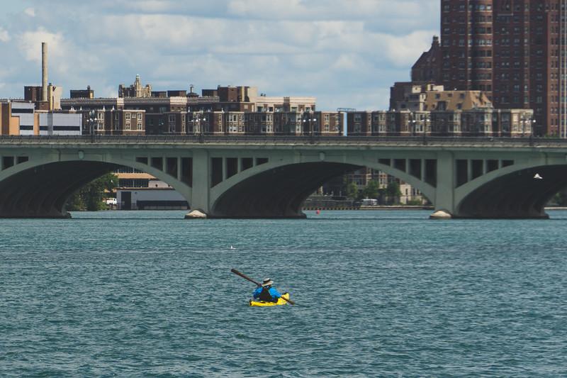 A Brave Kayaker on the Detroit River heading for the MacArthur Bridge