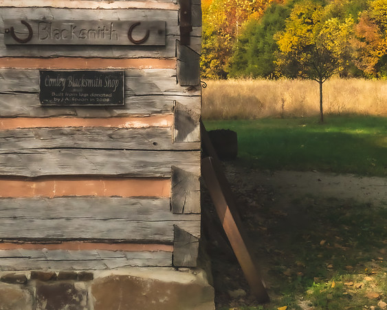 The Blacksmith Shop with Fall color in the back