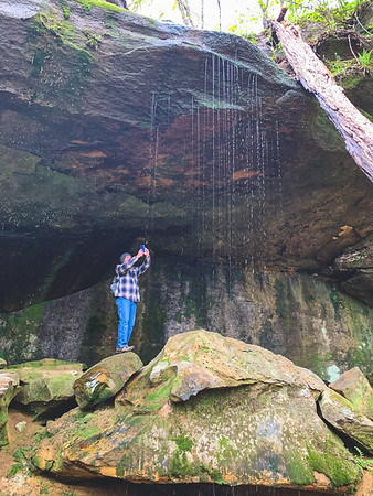 Tracy capturing the waterfall from the backside! This gives you some perspective of the scale of the rock formations!