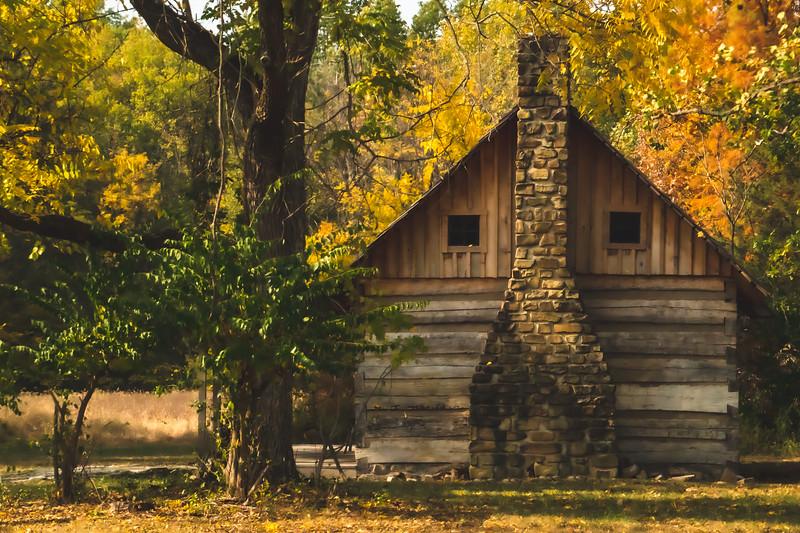Log Cabin among the Fall Trees