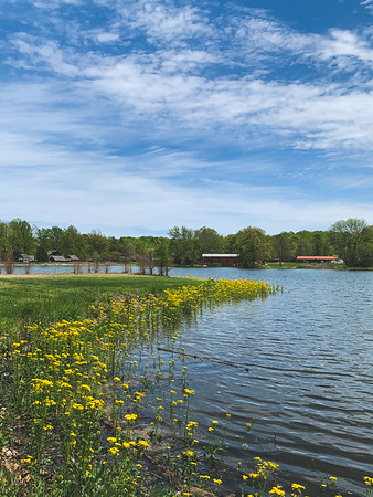 A view of the Pioneer Village and Irishmen Covered Bridge from across Fowler Lake