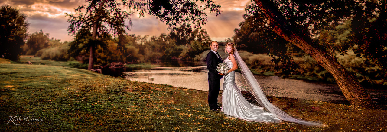 """We were amazed by this Fireman-inspired family wedding! at the Travioli River Ranch on the Kings River was a piece of property like we have never seen before. One of the most beautiful out of the way places we have ever seen for an elegant event! From the stunning bride and the wine cellar and the river vistas and the storm brewing in the background... It was amazing! Congratulations A.J. & Jen. We had a great time!  Via Wedding Wire -  5.0  Book it before they are booked up!!! Not only did my groom love Keith and Paula, my entire family is impressed by their helpfulness, professionalism, and willingness to make us all feel comfortable and laugh. Keith is like a ninja, everywhere with the camera but undetected. The value is in surpassable with any other photographer of their caliber. From engagment pictures, the wedding day, """"Glam the Dress"""", till the end product, we couldn't be happier!!! We have found our family photographer! Thanks Keith and Paula Mr. and Mrs. Happily Ever After ...aka Jen & AJ  FaceBook -  Jennifer DeWitt Milirides: Keith and Paula...you two captured all the best moments of the day with class and elegance. I can't express how grateful we are for the two of you participating in our day and going above and beyond for us. Paula made sure I was dressed and ready to go for my groom and Keith was like a ninja with the camera. He was everywhere but never to be seen. Thank you will never say enough...pictures made me cry! Happy Bride and Groom!  Terri Key-Buma: Your pictures should be in a wedding magazine! They are beautifully done.  Susan Hoffman: Absolutely beautiful !!  Jane Miller Ahrenberg: That is an amazing photograph, KeithandPaula Hartman!"""
