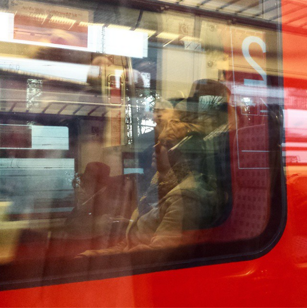 October: a napping commuter on a passing train in Munich, Germany
