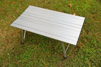 Folded aluminum table completely set up.