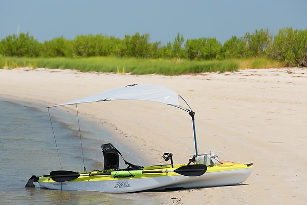My water transportation; a Hobie Passport 10.5 with a bimini cover.  I keep my photo gear in a dry bag on the back and a cooler with drinks and snacks on the front.