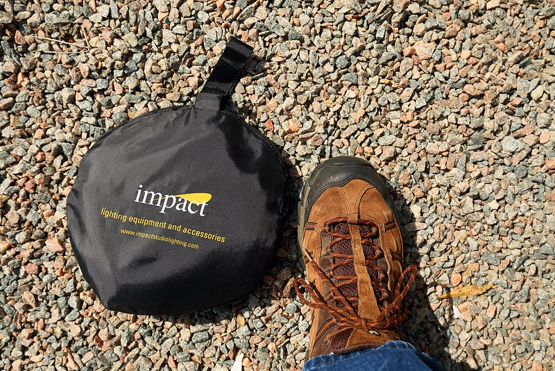 """Impact 5-1 32"""" photo disc in storage bag with my foot for size comparison."""
