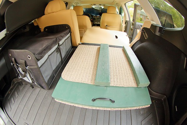 View from rear of the vehicle showing sleep support frame folded and stored behind the rear seat.