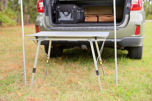 Aluminum table legs extended out in perfect spot to cook and eat seated on back bumper.