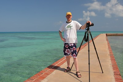 """Me at Fort Jefferson in the Dry Tortugas National Park with a friend's Gitzo carbon fiber tripod.  His has only two extendable leg sections but I always buy the three leg section/lock models because of their ability to extend taller than I am, and I am fairly tall at 6'4""""/191 cm."""
