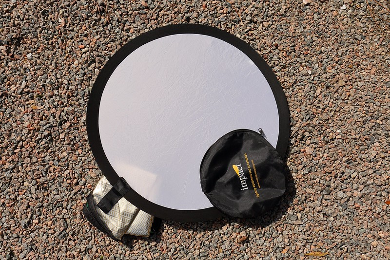 "Impact 5-1 32"" photo disc expanded showing translucent disc material, with storage bag on top at bottom right and folded up covering underneath at bottom left."